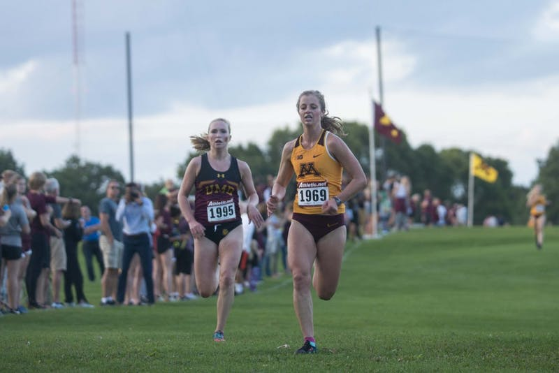 Redshirt Junior Kelsey Sather sprints to cross the finish line of the Oz Memorial at the Les Bolstad Golf Course on Friday, Sept. 6.