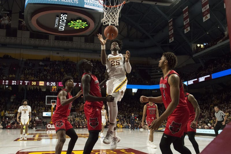 Freshman center Daniel Oturu jumps for the basket during the game against Arkansas State on Saturday, Dec. 8 at Williams Area.