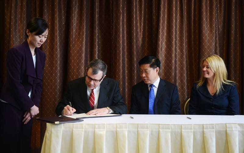 On behalf of the National Center for Food Protection and Defense, President Eric Kaler signs a memorandum of understanding with the Chinese Academy of Inspection and Quarantine.