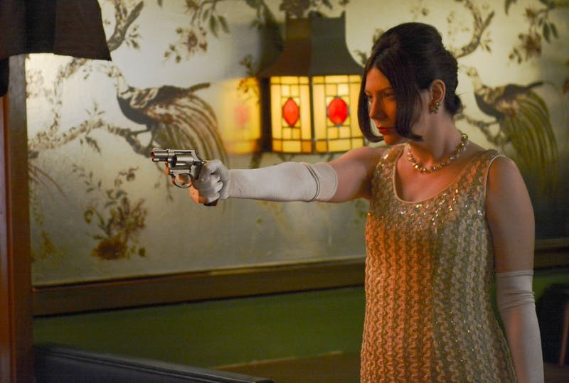 """Actress Rachel Grubb rehearses a scene from """"The Tiki War"""" before filming at the Red Dragon in Minneapolis early Sunday morning. """"The Tiki War"""" is director John Ervin's fifth film production."""