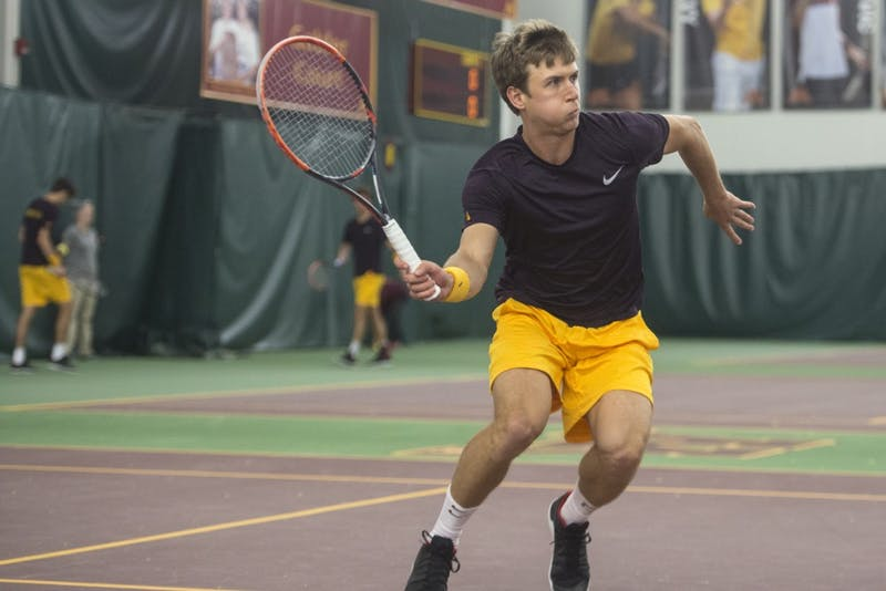 Senior Matic Spec returns the ball during a game against Ohio State at Baseline Tennis Center on Friday, March 30.