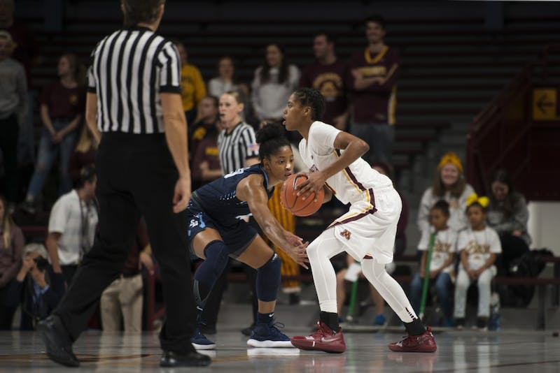 Redshirt Senior Guard Kenisha Bell looks to pass the ball during the game against San Diego on Saturday, Nov. 17 at Williams Arena.