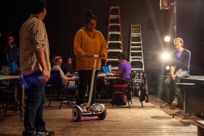"Actress Sushma Saha tries out a new means of transportation during a break at a rehearsal for ""Interstate"" at MixedBlood Theatre on Tuesday, Feb. 18. The production, created by Kit Yan and Melissa Li, follows the experiences of two trans people, navigating a myriad of cultural issues."