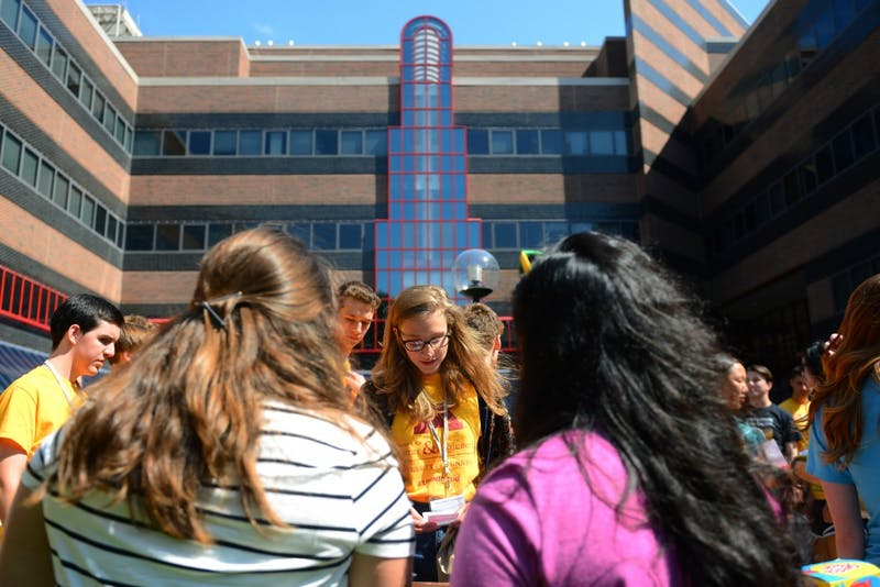 Freshman Elsa Forberger, center, speaks to Ellie Burns, left, and Ashmita Sarma about the Association for Computing Machinery for Women on Thursday, Aug. 30 outside of Lind Hall on East Bank. The College of Science and Engineering held an activities fair for incoming freshmen.