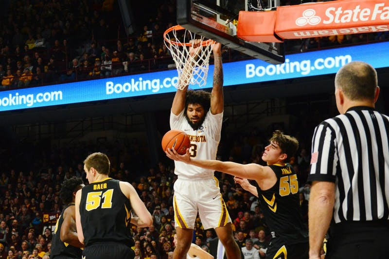 Jordan Murphy watches as Iowa catches his basket on Sunday, Jan. 27 at Williams Arena.