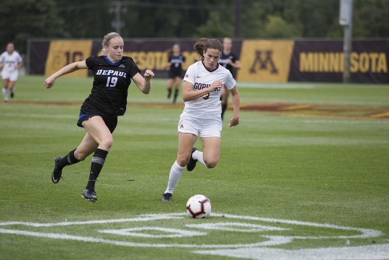 Freshman Delaney Stekr pushes to beat her opponent to the ball during the game against DePaul on Thursday, Aug. 30 at Elizabeth Lyle Robbie Stadium.