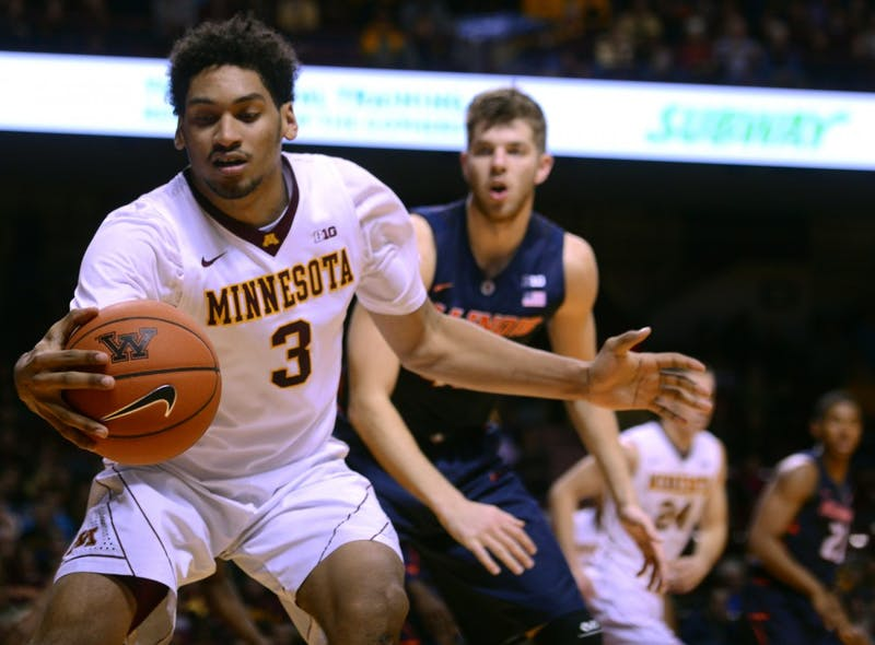 Gopher forward Jordan Murphy handles the ball Saturday, Jan. 23 at Williams Arena where the Gophers were defeated 71-76 in overtime.