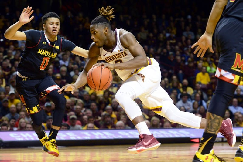 Grad student Akeem Springs drives the ball up the court on Saturday, Jan. 28, at the Sports Pavilion. The Gophers lost 78-85 against the University of Maryland Terrapins.