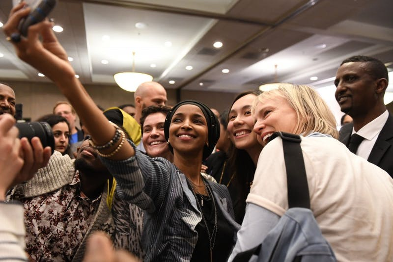 Fifth congressional district seat winner Ilhan Omar takes a selfie with supporters at her election party on Tuesday, Nov. 6 at the Courtyard by Marriott in downtown Minneapolis.