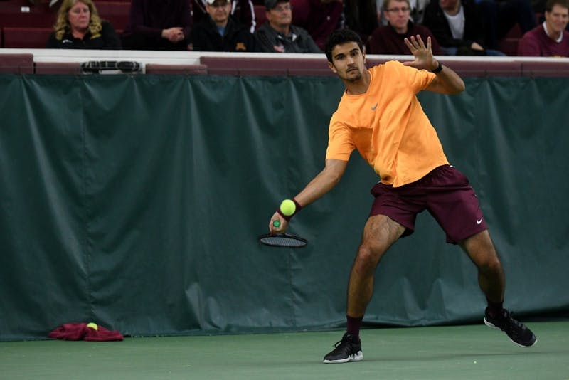 Senior Josip Krstanovic returns the ball on Friday, March 22 at the Baseline Tennis Center.