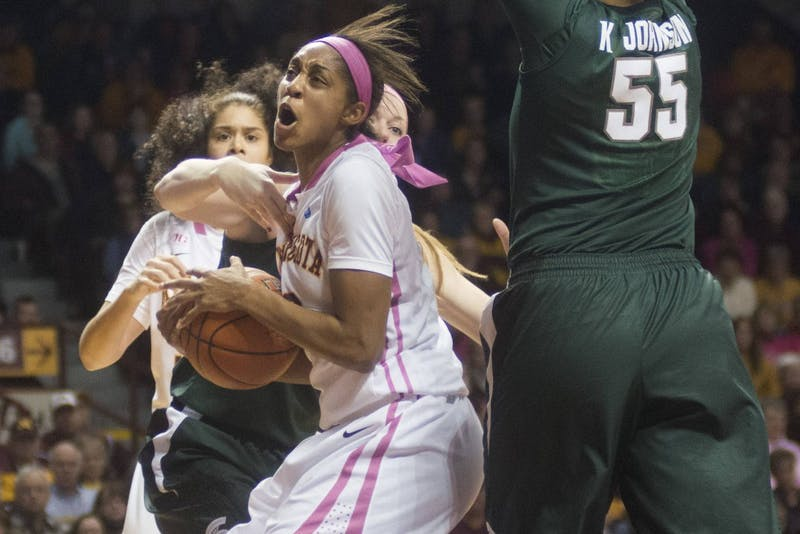 Minnesota forward Shae Kelley drives past Michigan State defenders during the second half at Williams Arena on 