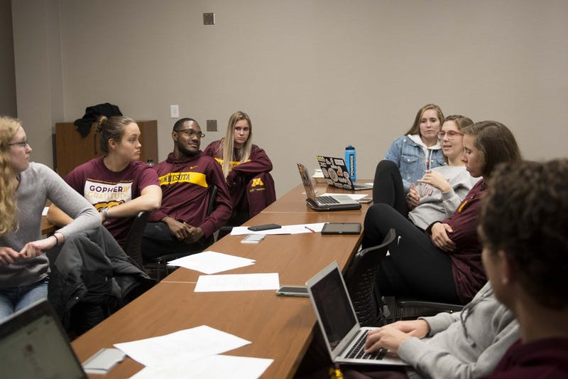 Students part of the Athletes Supporting Advocacy and Prevention group meet in the Bierman Athletic Building on Monday, Nov. 18. Participants have all undergone bystander training and formed the ASAP group to promote bystander intervention.