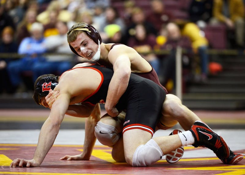 Tommy Thorn competes against Rutgers wrestler Anthony Ashnault in the 141-pound matchup at the Sports Pavilion on Jan. 17, 2016.