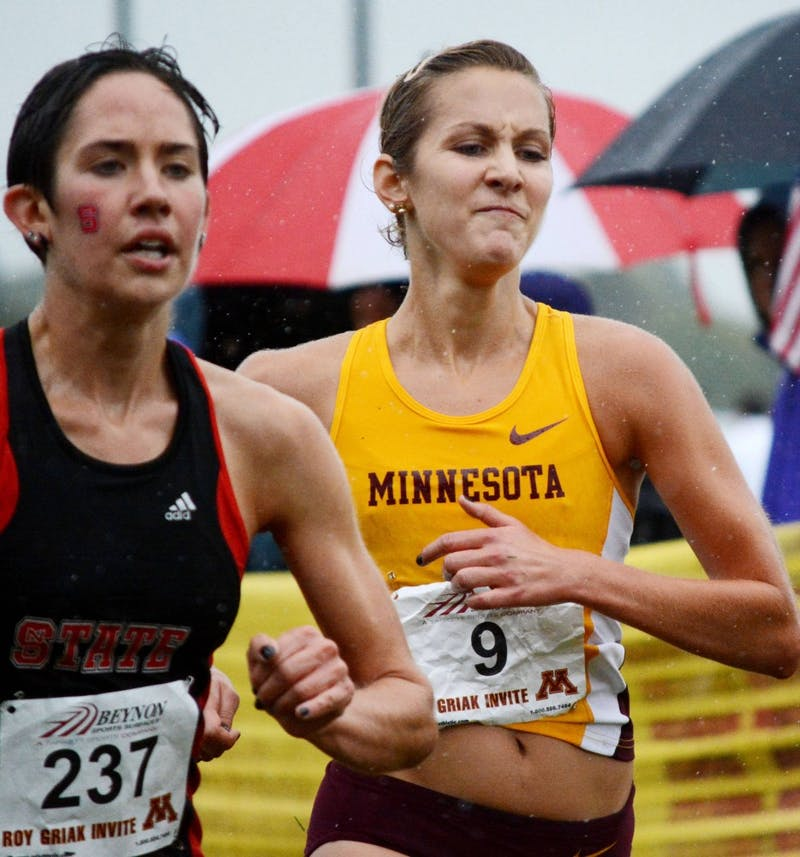 Minnesota senior Laura Docherty finishes behind North Carolina State's Joanna Thompson in the women's Division I Roy Griak Invitational on Sept. 28 at Les Bolstad Golf Course.