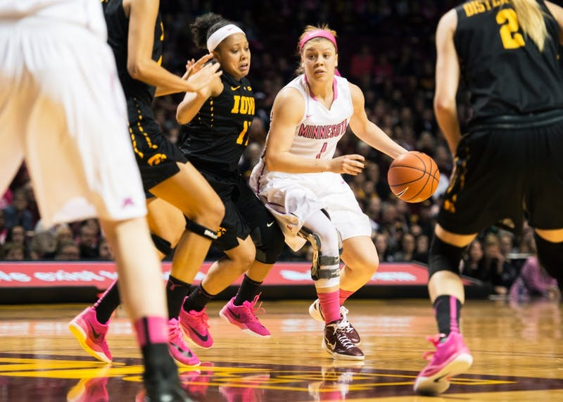 Rachel Banham looks to pass the ball during the second quarter at Williams Arena on Feb 15.