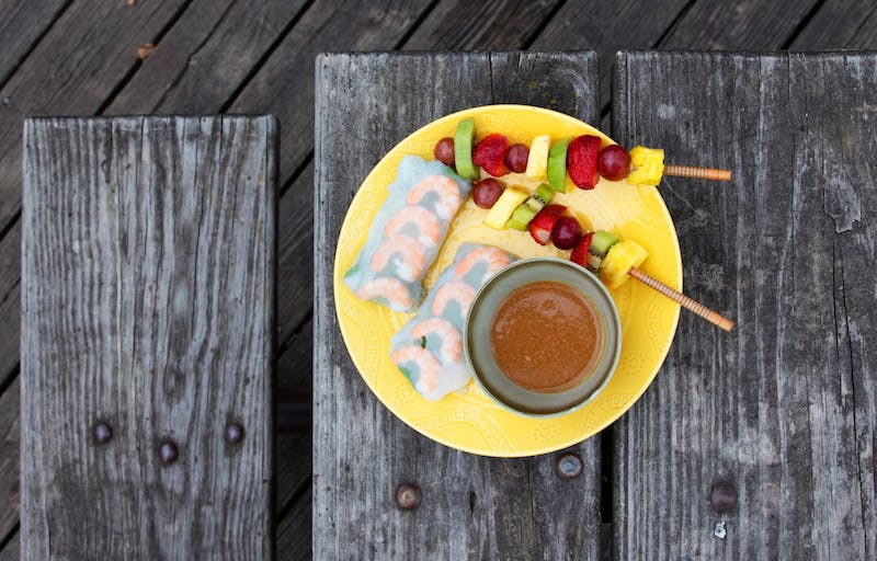 A picnic plate of fruit kebabs and shrimp spring rolls in Nicollet Island Pavilion on Tuesday, June 9. (Audrey Rauth / Minnesota Daily)
