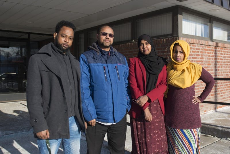 Freelance interpreters Ahmed Hassan, AK Hassan, Suad Muse and Huda Mire pose for a portrait outside of the Hiawatha Business Center in Minneapolis on Wednesday, March 6.
