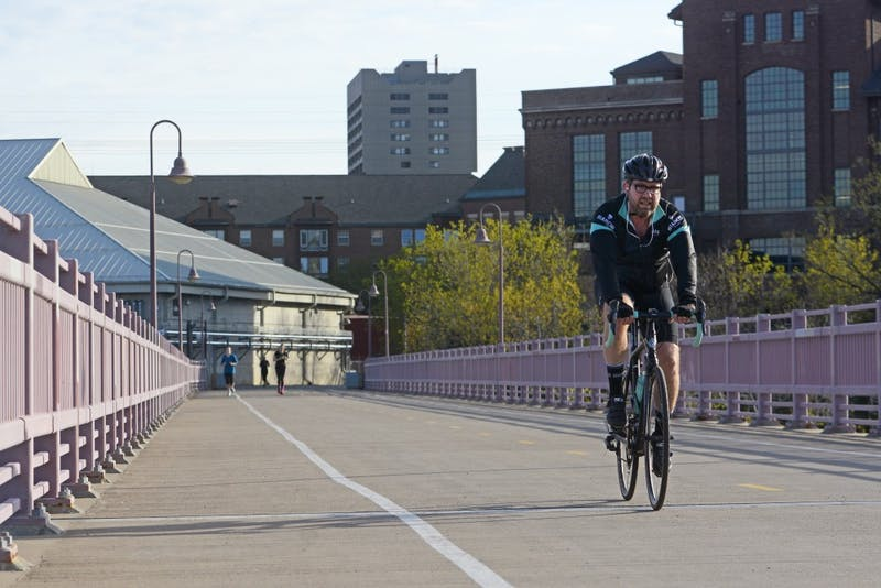 A cyclist crosses the Mississippi River on the Dinkytown Greenway on Sunday, April 23, 2017.
