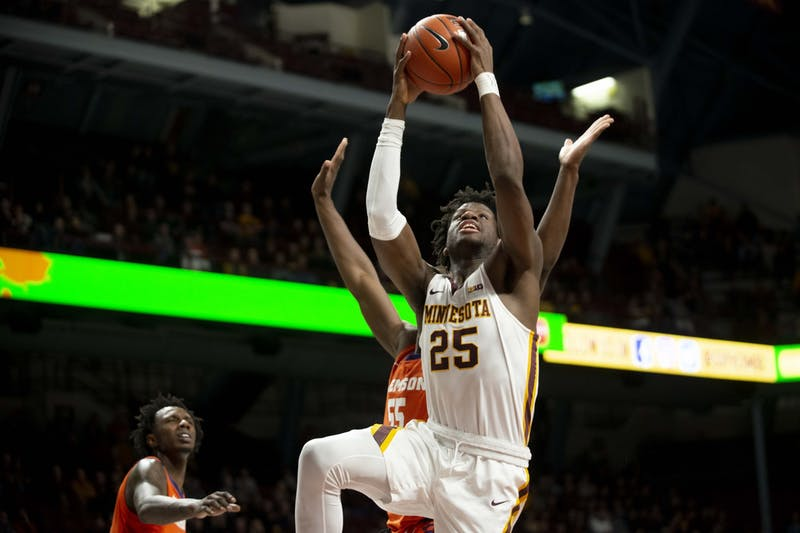 Center Daniel Oturu does a layup at Williams Arena on Monday, Dec. 2. The Gophers defeated Clemson 78-60.