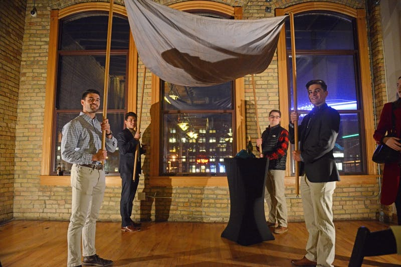 Attendees hold up the the chuppah during the My Big Fat Jewish Wedding event at Day Block Event Center downtown on Thursday, March 22.