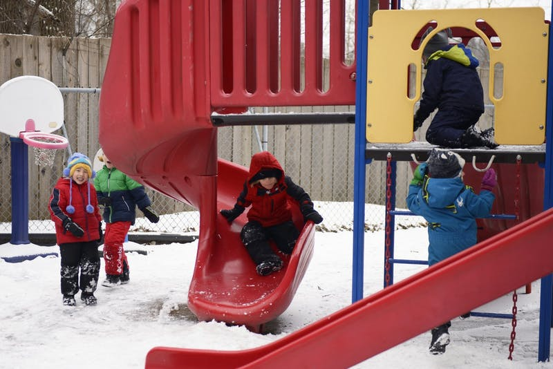 Children play outside at the Community Child Care Center at the University of Minnesota in St. Paul on Monday, Jan. 30, 2017.