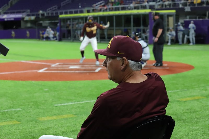 Gophers Head Coach John Anderson observes the game and provides feedback to players at U.S Bank Stadium on Saturday, Feb. 29. The Gophers fell to Duke 3-7.
