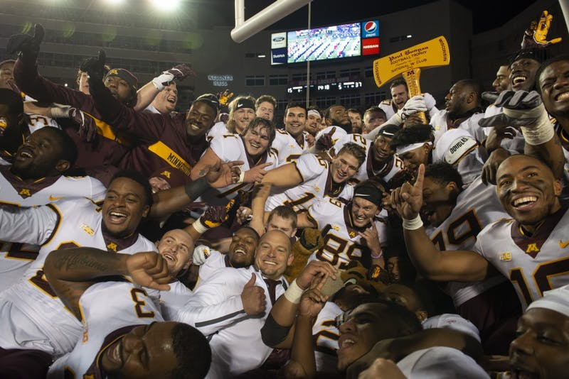 The Gophers take a group picture at Camp Randall Stadium in Madison on Saturday, Nov. 24. The Gophers beat the Badgers 37-15 for the first time since 2003.