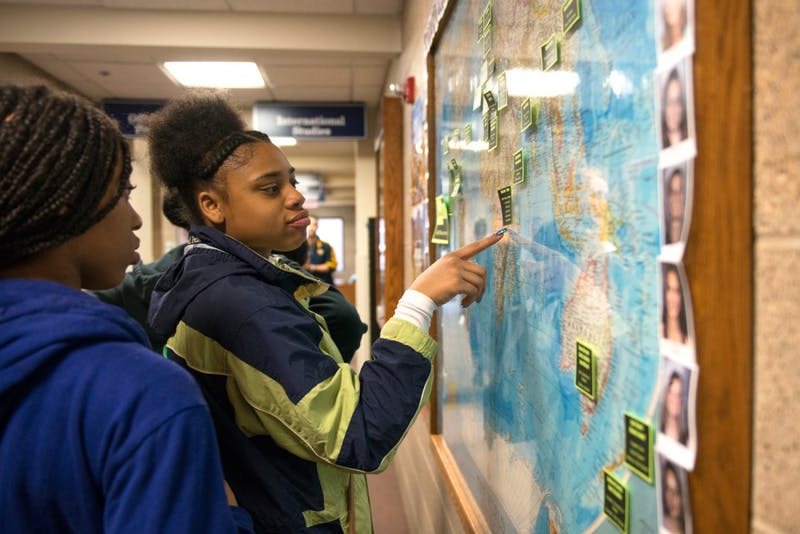 High school sophomore Sakhila Islam points to a country on a map of study abroad opportunities during a tour at Bethel University on Tuesday. Islam, who hopes to study theater in college and study abroad in Puerto Rico, is a part of Girls in Action, a program aimed at mentoring high school girls and leading them in the direction of college and careers by giving them leadership skills and service opportunities.