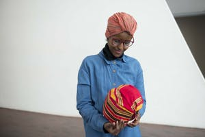 Artist and teacher Ifrah Mansour looks at a miniature Aqal, a traditional nomadic Somali hut, she created an exhibit she  hosted at the Walker Art Center on Saturday, Dec 7. A Somali refugee herself, Mansour aims to create art that promotes social justice.