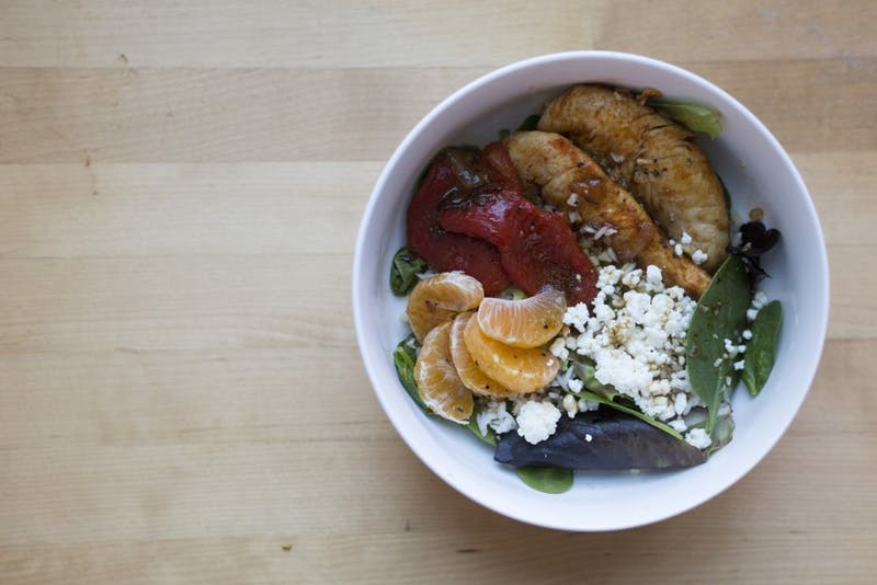 """Minnesota Daily reporter Maddy Folstein chopped, sautéed and peeled to assemble a """"greens and grains"""" salad for the newspaper's College Kitchen segment on Friday, Jan. 19."""