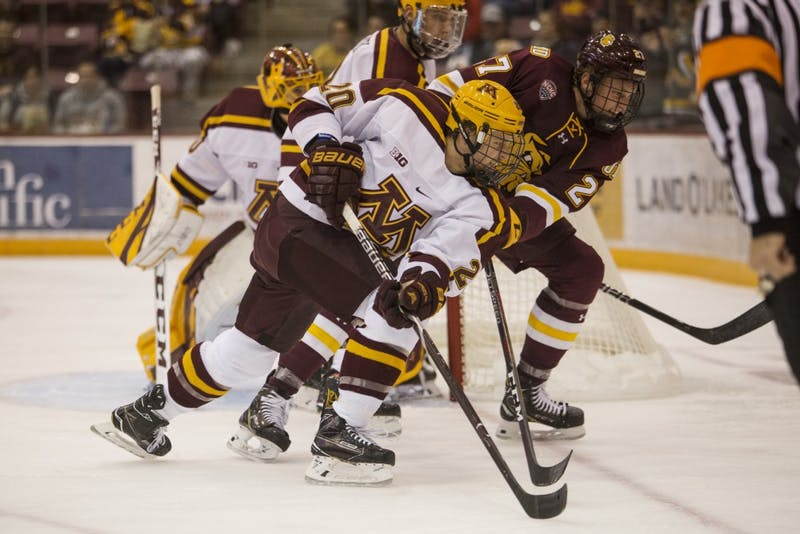Junior Ryan Zuhlsdorf skates past the University of Minnesota Duluth toward the puck during the game on Sunday, Oct. 7 at Mariucci Arena. The Gophers won 7-4.