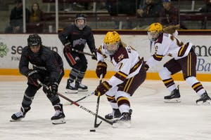 Forward Taylor Williamson looks to control the puck at Ridder Arena on Friday, Oct. 19. The Gophers beat Ohio State 3-0.