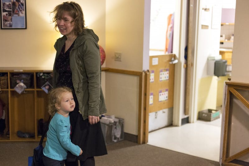 University Public Health Researcher Stephanie Jarosek says goodbye to her 3-year-old Ruth while dropping her off at the University of Minnesota Child Development Center on Wednesday, Oct. 4 in Minneapolis. Jarosek is among the parents that were happy to hear the University opted out of closing the CDC.