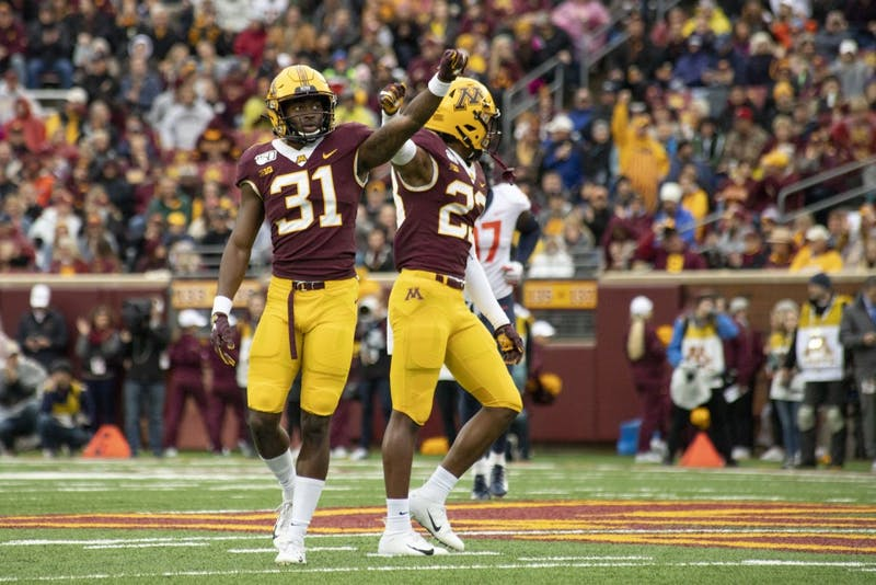 Defensive backs Kiondre Thomas and Jordan Howden hold up their fists at TCF Bank Stadium on Saturday, Oct. 5, 2019. The Gophers defeated Illinois 40 to 17 to bring their record to 5-0.