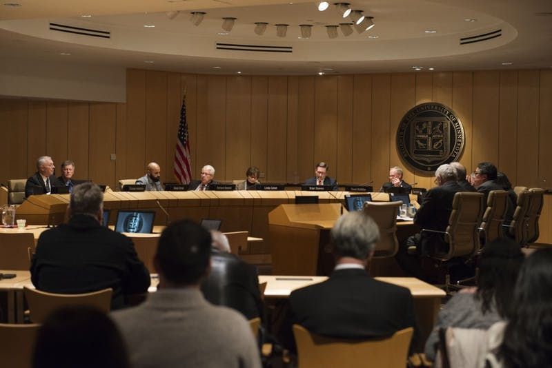 Members of the Board of Regents converse during their meeting on Wednesday, Dec. 5, where they discussed the finalists for the next presidential of the University.
