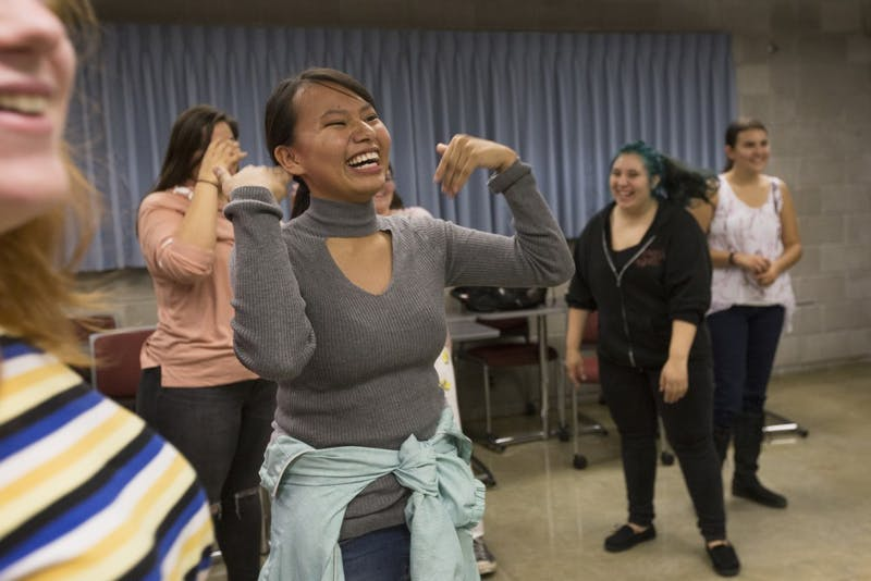 Native American Studies student Claudia Iron Hawk fans herself during her traditional Native American dance class on Wednesday, Oct. 3 at the University of Minnesota-Morris campus.