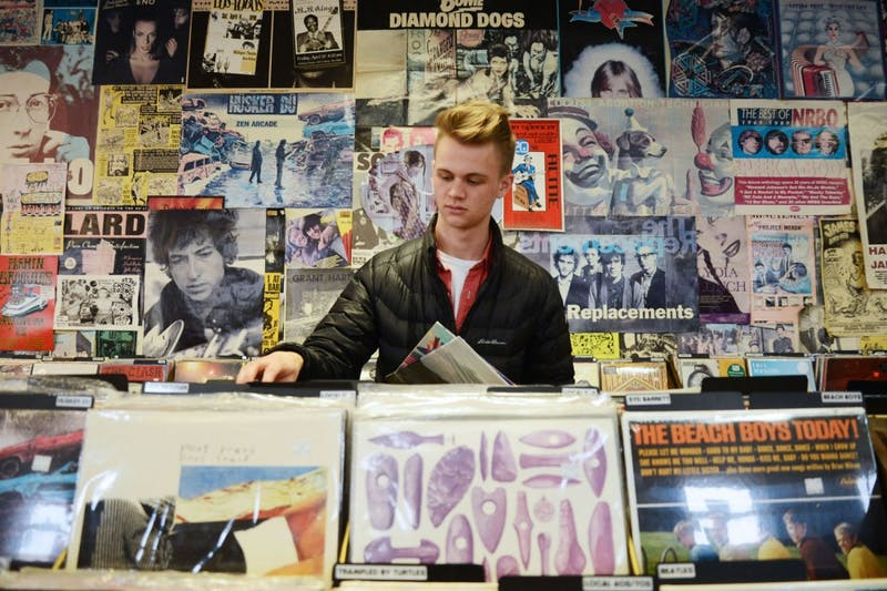 Global studies and history major Tyler Boesch looks at vinyl records at Treehouse Records in Minneapolis on Jan. 19, 2015.