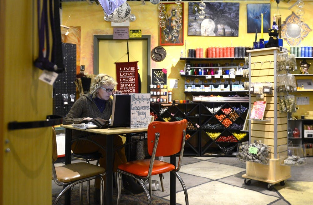 Holly Burns heard a whisper in her ear. Now she's a psychic reader at Magus.