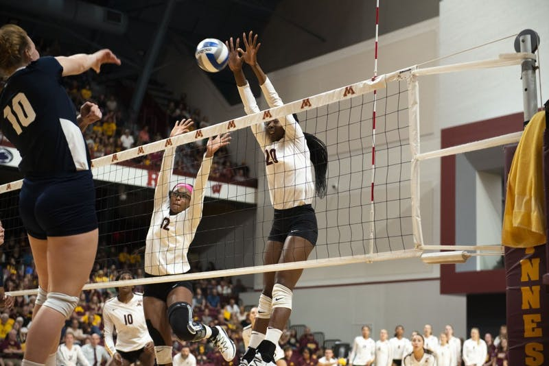 Redshirt Senior Taylor Morgan, left, and Sophomore Adanna Rollins, right, jump to block a spike at the Maturi Pavilion on Saturday, Sept. 21, 2019. The Gophers defeated Oral Roberts three matches to none.