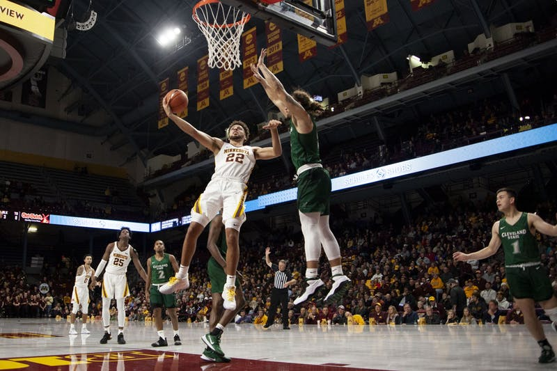 Guard Gabe Kalsheur leaps past a defender at Williams Arena on Tuesday, Nov. 5. The Gophers went on to defeat Cleveland State 85-50.