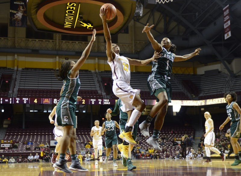 Redshirt junior guard Kenisha Bell scores for the Gophers on Sunday, Dec. 3 at Williams Arena.