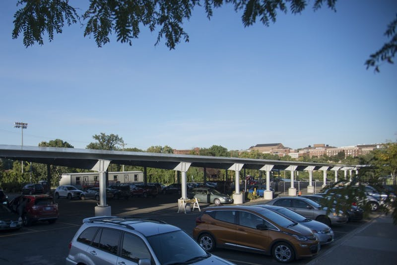 New solar panels shade the parking lot outside Humphrey School of Public Affairs on Wednesday, Sept. 26. The solar panels are part of a University effort to eliminate net carbon emissions by 2050.