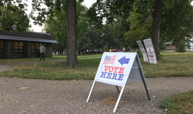 A man enters the building at Van Cleave Park, one of several polling locations around the University of Minnesota, to vote in Minnesota's primary elections on Tuesday, Aug. 14, 2018.