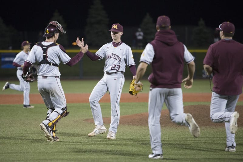 Freshman Max Meyer is congratulated after closing out the win against UCLA on Saturday, June 2, 2018 at Siebert Field. The Gophers won 3-2.