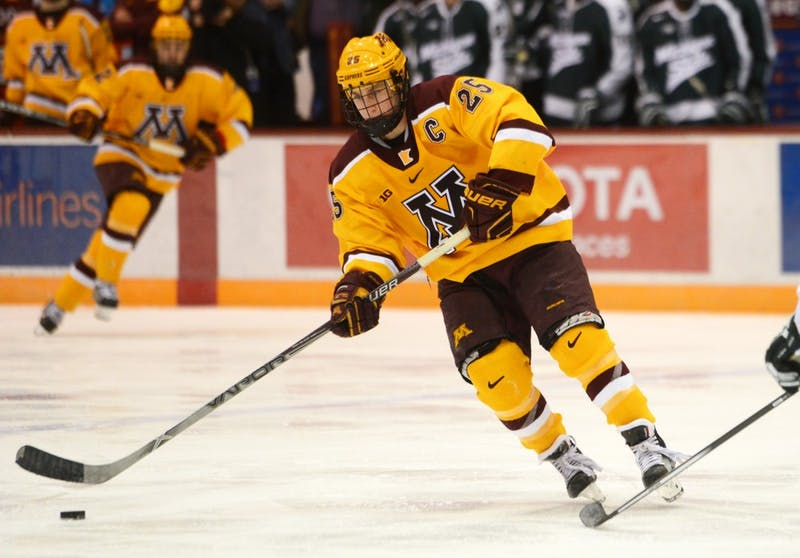 Gophers forward Justin Kloos handles the puck at Mariucci Arena on Jan. 16.