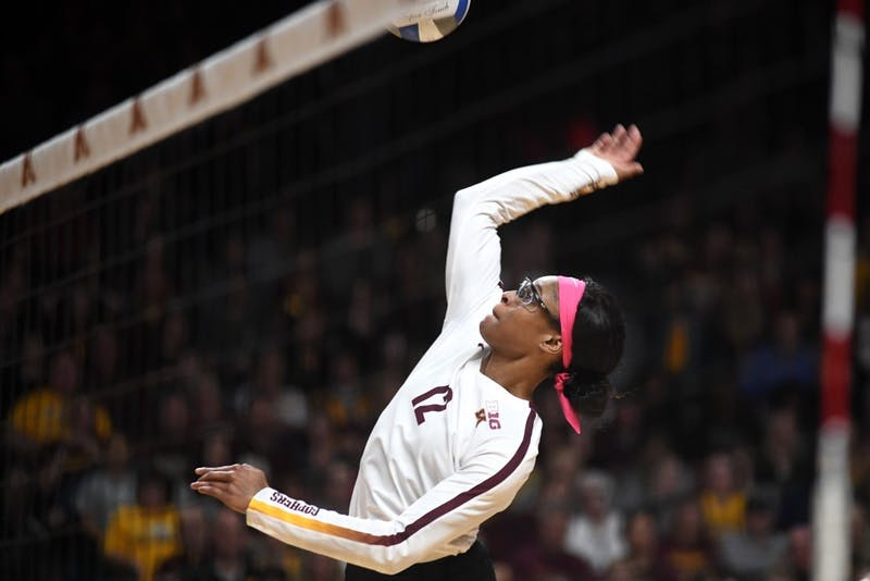 Redshirt Junior Taylor Morgan spikes the ball on Friday, Oct. 19, 2018 at Maturi Pavilion.