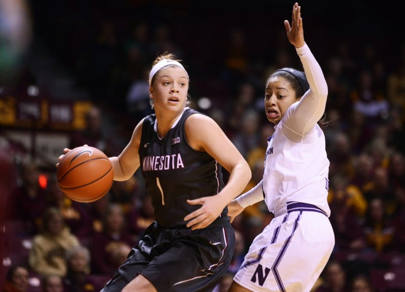 Minnesota guard Rachel Banham looks up court while shielding the ball from Northwestern guard Ashley Deary at Williams Arena on Jan. 20, where the Gophers won 95-92.
