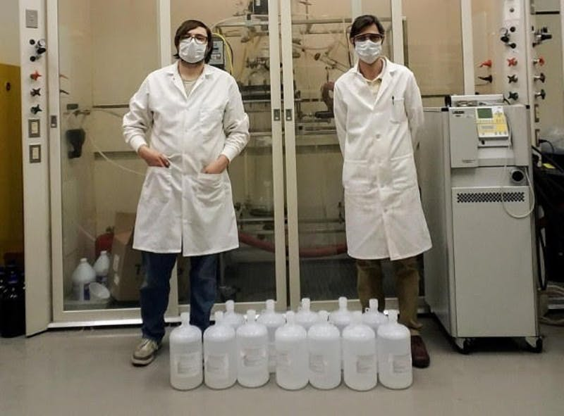 Institute for Therapeutics Discovery and Development scientists, from left, Andrew J. Goode and Dr. Ricardo Gallardo-Macias standing with sanitizer.
