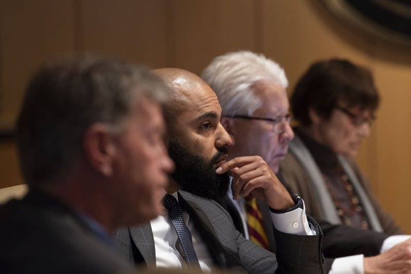Regent Abdul Omari listens in on the Board of Regents' special session on Friday, April 26. The board voted against the renaming of four buildings on campus after more than a year of community discussion on the issue.