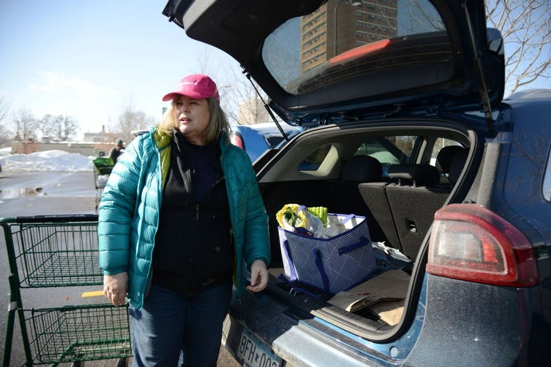 Allison Sandve loads her plastic-free groceries into her car on Sunday, Feb. 24 at the Seward Community Co-op in Minneapolis. Sandve started living a plastic-free lifestyle almost a year ago and plans to continue exploring ways to incorporate sustainability into her life.